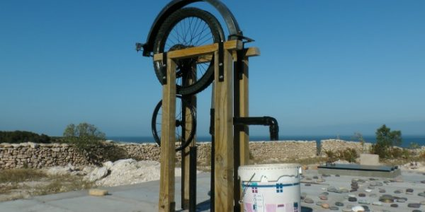 A rope pump over the main cisterna.